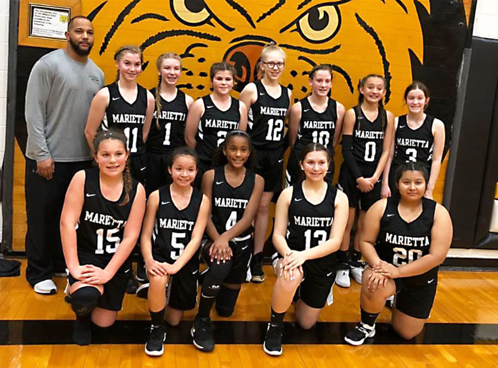 Junior High Lady Indians celebrate undefeated seasons