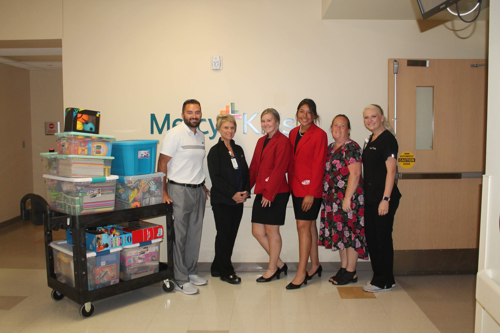 FCCLA teacher Amanda Faulkenberry, head girls basketball coach Josh Drinning, Heaven Sustaire and Yaslin Sanchez, representing Marietta HS FCCLA, donated over 550 toys crayons and coloring books to Mercy of Ardmore's pediatric center.